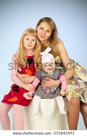 mother and two daughter in a studio - stock photo