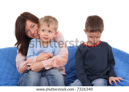 mother and two sons on the sofa - portrait - stock photo