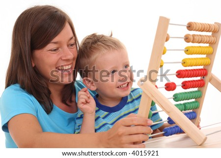 mother and 3-4 years old boy with big abacus isolated on white
