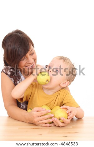 mother and 3-4 years old boy with fresh pears isolated on white
