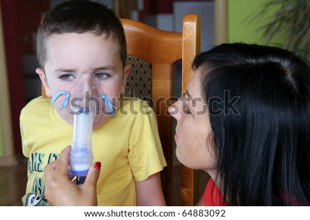 Mother and 5 years old child taking respiratory, inhalation therapy. - stock photo