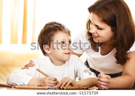mother and 6 years old son drawing together - stock photo