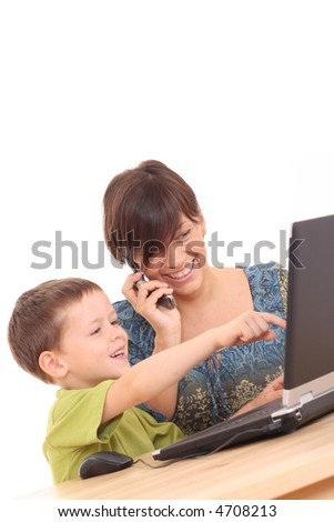 mother and 5-6 years old son having fun with computer game isolated on white - stock photo