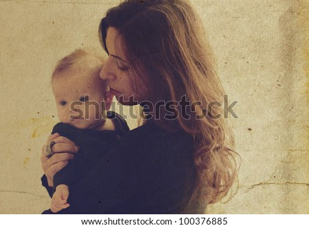 mother and young daughter at home. Photo in old image style. - stock photo