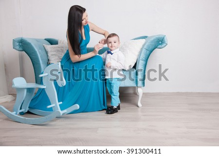 Mother and young son in the interior, family - stock photo