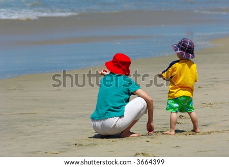Mother and Young Son On Beach - stock photo