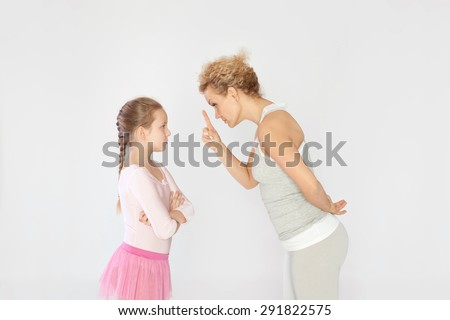 Mother arguing with her daughter - stock photo