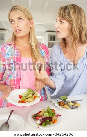 Mother arguing with teenage daughter - stock photo