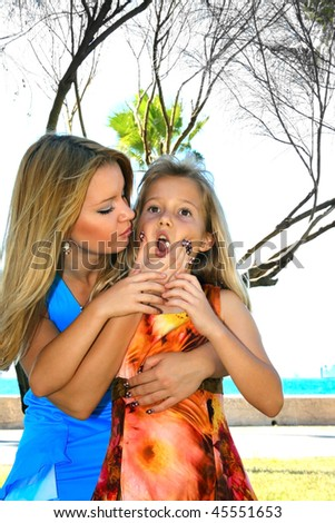 Mother asking daughter take out chewing gum. - stock photo