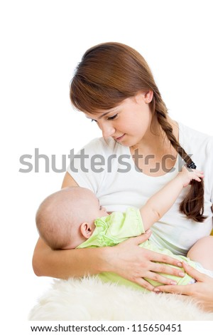 mother breast feeding and hugging her baby girl isolated on white - stock photo