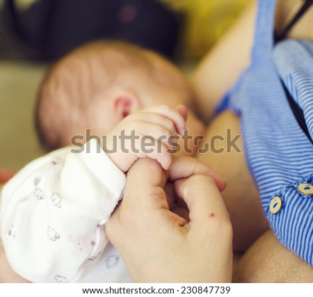 Mother breast feeding her baby - stock photo