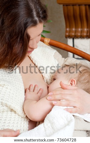 Mother breast feeding her infant