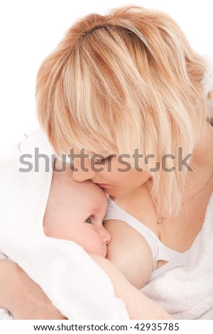 Mother breast feeding her newborn baby girl. Isolated on white - stock photo