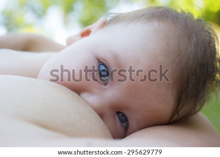 Mother breastfeeding her three months old boy  - stock photo