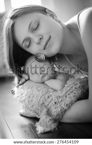 Mother caresses the child