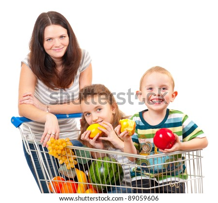 Mother carries her children in a shopping cart isolated over white - stock photo