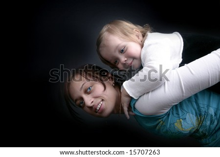 Mother carrying baby on back - stock photo