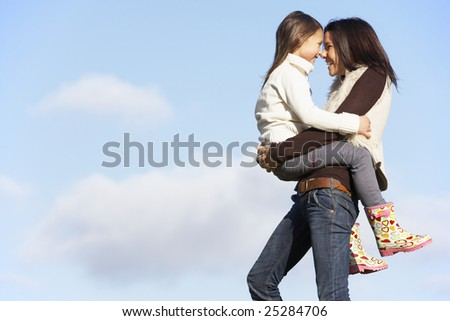 Mother Carrying Her Daughter - stock photo