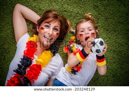 mother child soccer fan