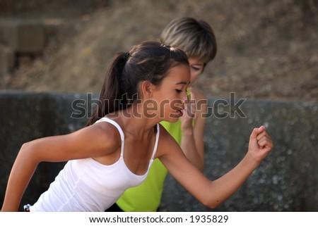 Mother coaching her teenage daughter - stock photo