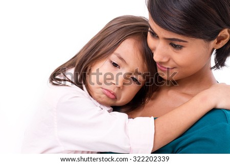 mother comforting, caring her daughter in unhappy, sad, negative emotion - stock photo