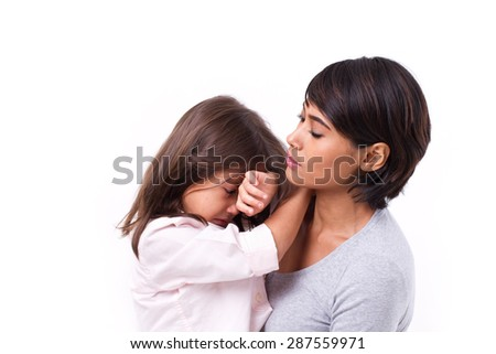mother comforting crying daughter, family problem solution - stock photo