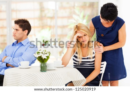 mother comforting daughter when she has relationship difficulties - stock photo