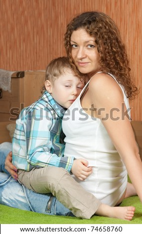 Mother comforting four year old son - stock photo