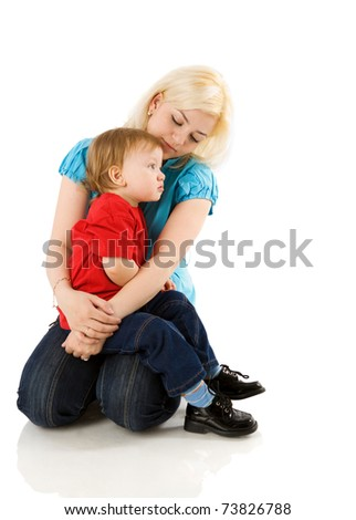 Mother comforting sick son's sitting isolated on white - stock photo