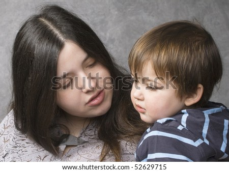 Mother consoling her son - stock photo