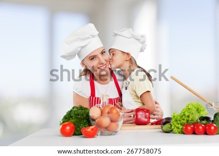 Mother, cooking, kitchen. - stock photo