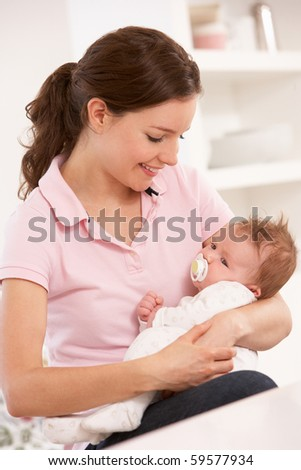 Mother Cuddling Baby Boy At Home - stock photo