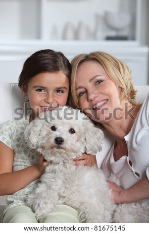 Mother, daughter and dog - stock photo