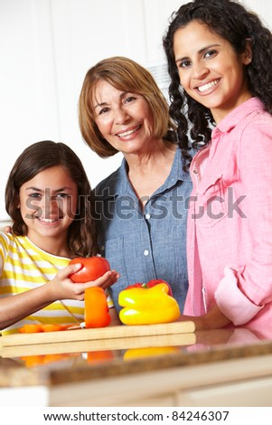 Mother,daughter and grandmother cooking - stock photo