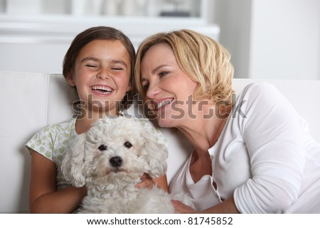 Mother, daughter and the dog - stock photo