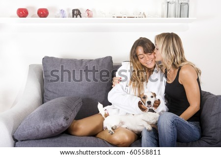 mother daughter and their dog sharing a moment of happiness