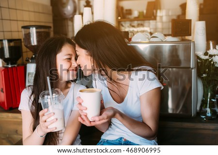 mother daughter drink espresso in the cafeteria