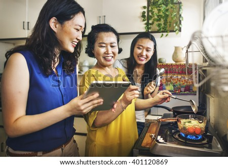 Mother Daughter Happiness Cooking Activity Concept - stock photo