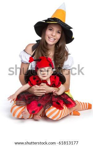 Mother daughter wearing halloween costume - stock photo