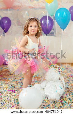 Mother day concept. Happy young girl celebrate birthday playing confetti.  - stock photo