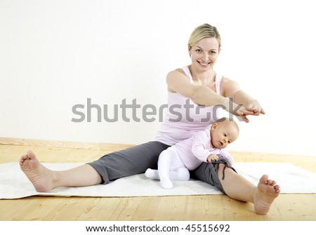 mother does gymnastics with her baby