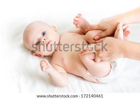 mother doing gymnastics her baby infant - stock photo