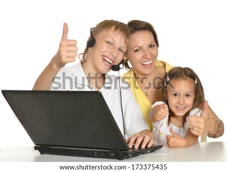 Mother doing homework together with her son and daughter - stock photo