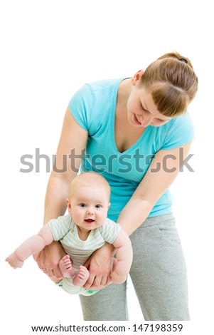 mother doing yoga with baby isolated - stock photo