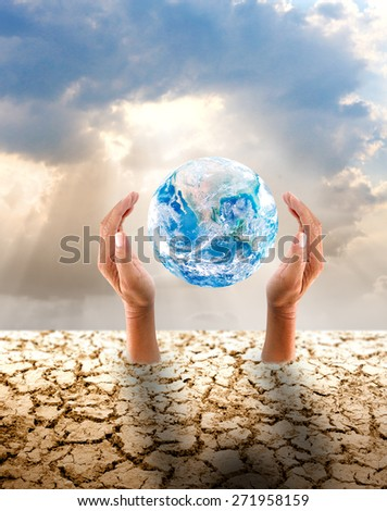 Mother Earth hands hold global from cracked land over sunny cloudy sky a Green Earth Conserve concept Elements of this image furnished by NASA - stock photo