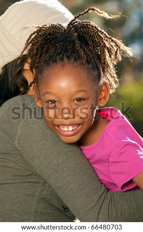 Mother Embracing Child - stock photo