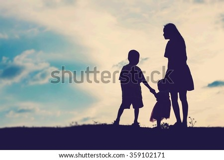 Mother encouraged her son and daughter outside at sunset