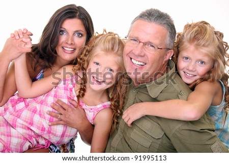 Mother,father and cute twin kids - stock photo