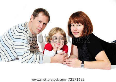 mother, father and daughter laying on over the white
