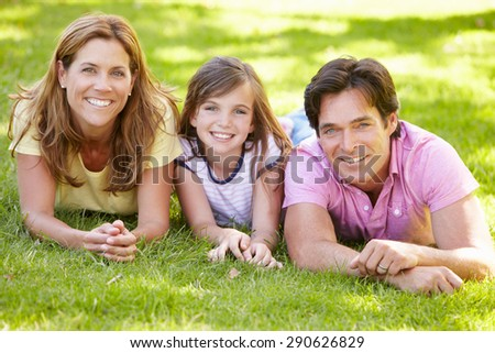 Mother, father and daughter outdoors